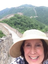 Biology teacher Denise Green visiting the Great Wall of China.