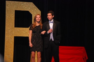 Senior Mack Hilliard escorting freshman Caroline Cipolla.