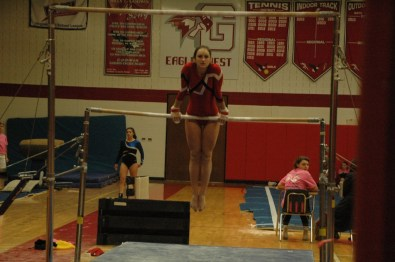 Senior Maddy Greene on uneven bars.