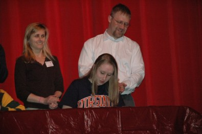 Jessie Gvozdas signing her letter of intent to swim at University of Virginia