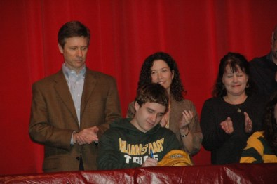 Brett Barden signing his letter of intent to swim at William and Mary