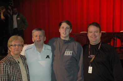 Jacob Kessler with his parents and Godwin basketball coach Hunter Thomas (r)