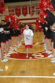 Sarah Platea running onto the court