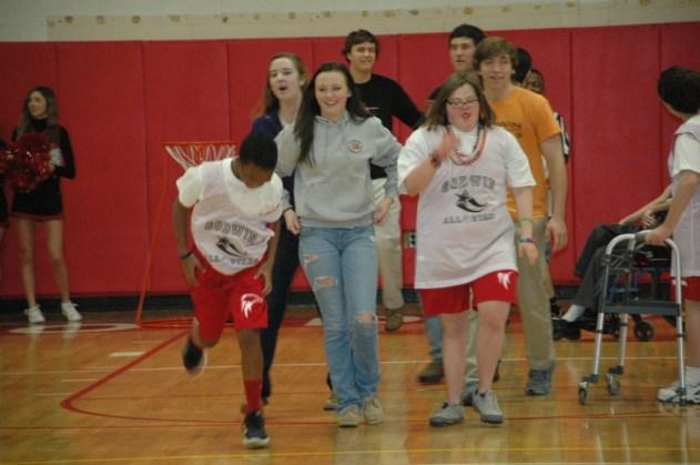 Noah Lowry and Katie Stoyanoff run down the court.