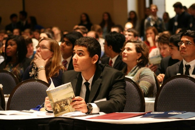 Godwin MUN team listens to the Opening Ceremony's speakers.