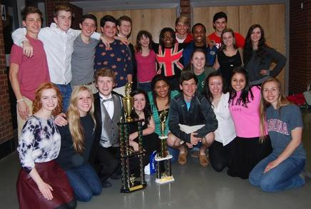 Madrigals with their first place and Grand Champ trophies
