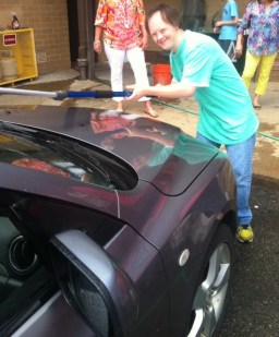 Owen Hicks happily washing a car.