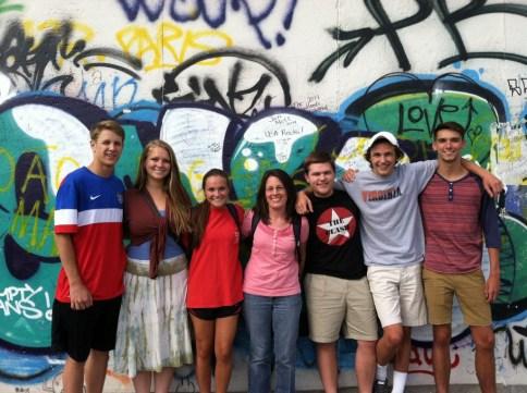 Macklin and students at the Berlin Wall.