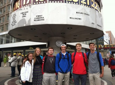 German teacher Kristin Macklin and students in front of the Brandenburg Gate.