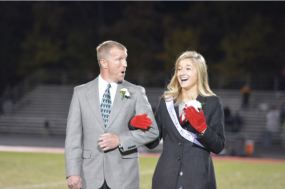 Senior Hailey Gutzmer and father when they heard that Hailey was 2014 Homecoming Queen.