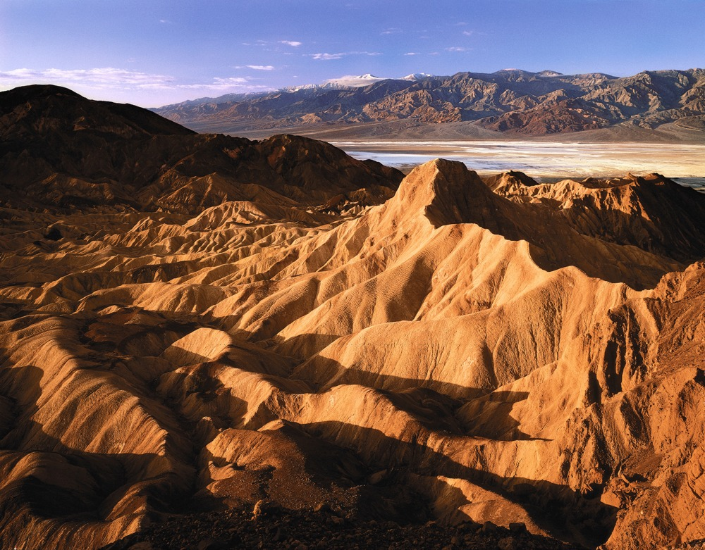 Scenic view of Death Valley sand dunes and mountains.
