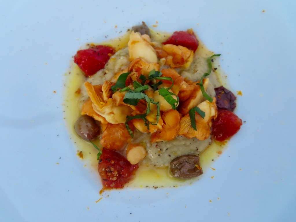 Symphony of chanterelles, cream of roasted eggplant, dried tomatoes and fresh basil.