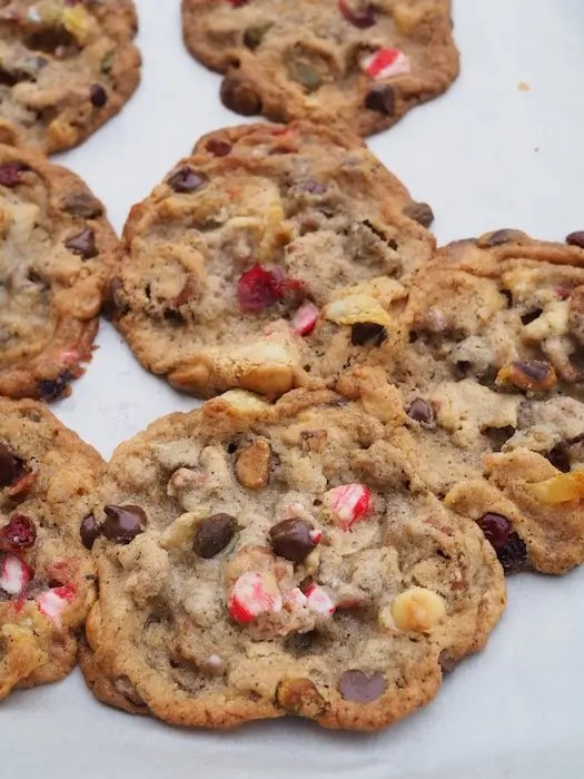 Epic Kitchen Sink Cookies Recipe with Christmas theme chock full of flavor and texture goodness with dried cranberries, pistachios, peppermint candy, white and dark chocolate, potato chips and mini pretzels. Paired with CK Mondavi Wines. Recipe adapted from Milk Bar Compost Cookie recipe by GoEpicurista.com