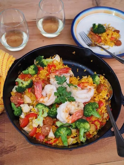 Easy Everything But The Kitchen Sink Paella Recipe perfect for Spanish theme party or dinner main dish uses leftovers and a variety of ingredients you'll find in our pantry. Recipe by Tapa Toro Orlando and GoEpicurista.com