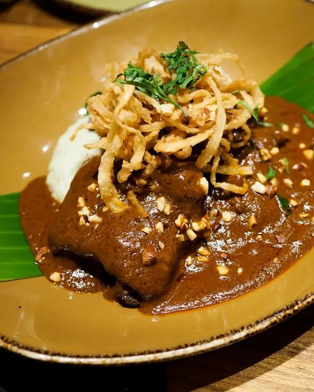 Roasted Short Rib with Mole de Almendras from Frontera Cocina at Disney Springs Taste of Oaxaca Seasonal Menu and Fun Random Facts about Mole including How To Make an Easy Mole from Chef Rick Bayless