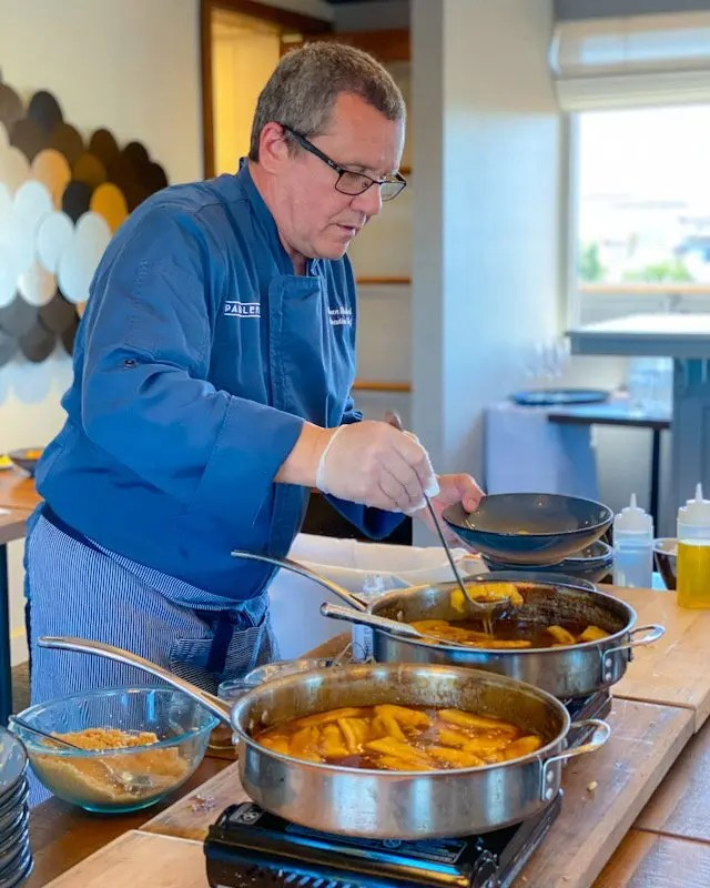 Chef Steven Richard of Paddlefish Orlando during Paddlefish New Orleans Cooking Class featuring Shrimp and Sausage Stuffed Mirlitons, Crawfish and Crab Etouffee, and Bananas Fosters. Recipes for Easy Entertaining at home. Host your own Mardi Gras Party any time of year!