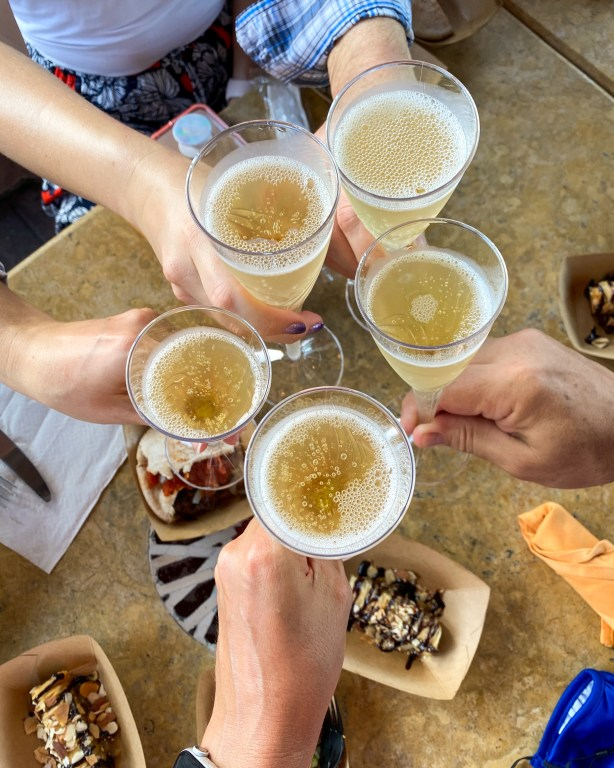Taste of Epcot Food and Wine Festival guide cheers at Spice Road Table