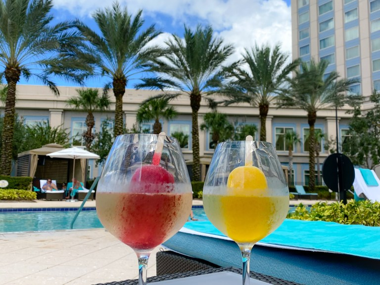 Best Orlando Resorts for Epic Foodie Getaways includes the Waldorf Astoria Orlando with Prosecco pop cocktails by the pool.