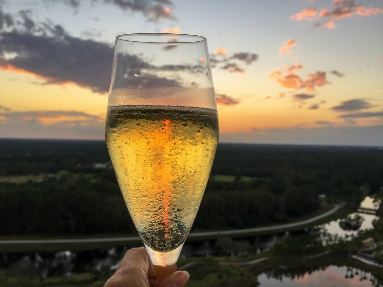 Best Orlando Resorts for epic foodie getaways includes Four Seasons Orlando Resort at Walt Disney World. Cheers from Capa Steakhouse.