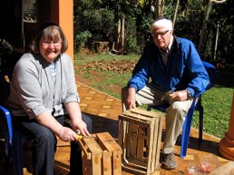 Mom and dad making end tables out of wooden crates