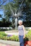 Mom with Bird Statue