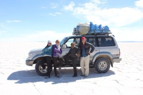 Bolivia Salt Flat Tour Crew Gathered Next to Land Cruiser