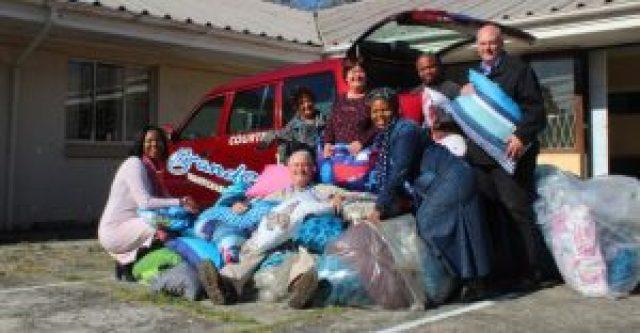 GIVING COMFORT: Brands Furnishers donated 100 pillows to EL Child Welfare last week. From left are Sipokazi Mazomba, Suraya Leeuw, Helena Archer, Lindyiso Yeko, Gary Reynolds, Bukiwe Langa and Brands CEO Percy Shaw (seated) Picture: QHAMANI LINGANI