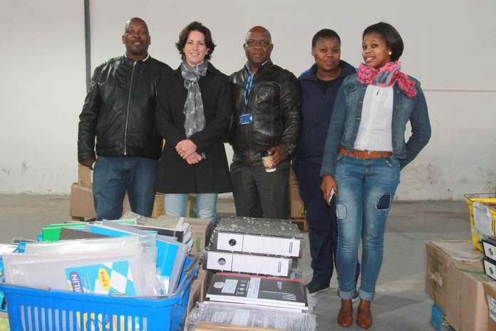 TEACHING MADE EASIER: The  Kempston  Group donated  stationery  to the value of over R700000 to various schools and charities in need last week. A total of 35 schools benefited from the pallets of  stationery  valued at R25000 each. Pictured are staff representatives from Smiling Valley Farm School receiving their donation. From left are PC Diniso,  Kempston  representative Gayle Flanegan, Mongezi Mncono principal, Sibahle Mgidi and Siphokazi Bheni Picture: SARAH KINGON
