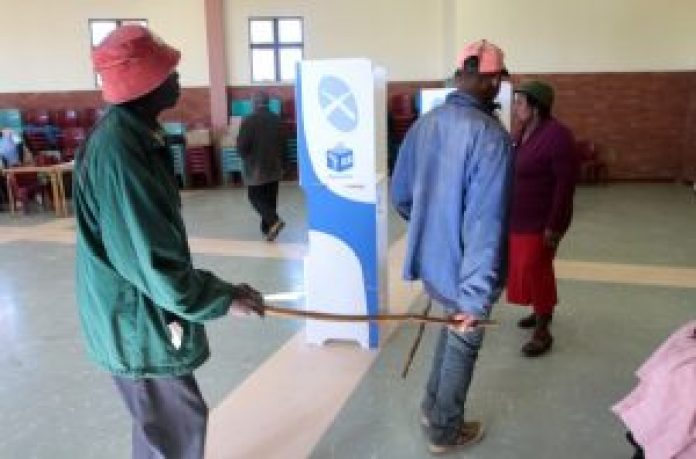 BIG MOMENT: A blind voter, Ntsompiyana Maxayi 77, is lead by his son Andile Maxayi 30, as a woman from the IEC helps them out in the last municipal elections in 2011. Government has teamed up with the IEC to provide voter education in the run-up to the August 3 municipal elections Picture: DAILY DISPATCH FILE