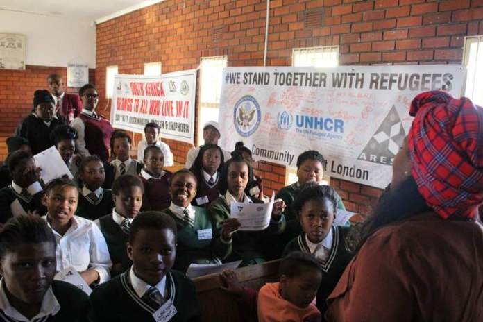 YOUNG ADVOCATES: Pupils from Sinovuyo High School, Ebenezer Majombozi High School and Kusile Comprehensive School attend a Peace Award Ceremony in Duncan Village on Wednesday, where they were awarded certificates for their involvement in a Peace Ambassador Training programme, which seeks to contribute to the successful integration of refugees in South African society