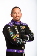 Jan 10, 2018; Brownsburg, IN, USA; NHRA funny car driver Jack Beckman poses for a portrait during a photo shoot at Don Schumacher Racing. Mandatory Credit: Mark J. Rebilas-USA TODAY Sports