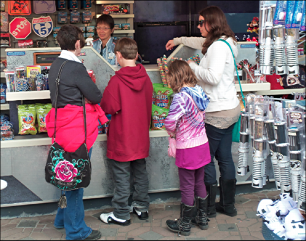 disneyland kids buying candy