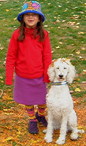 a girl and her dog standard poodle white