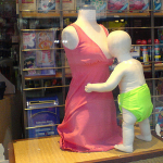 Nursing Baby Mannequin in Shop Window