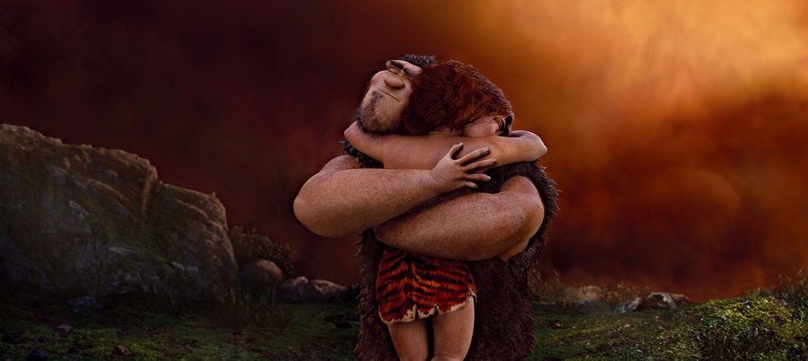 Grug (Nicolas Cage) hugs daughter Eep (Emma Stone) in The Croods