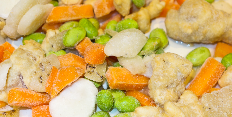 frozen food in the frying pan, ready to cook up