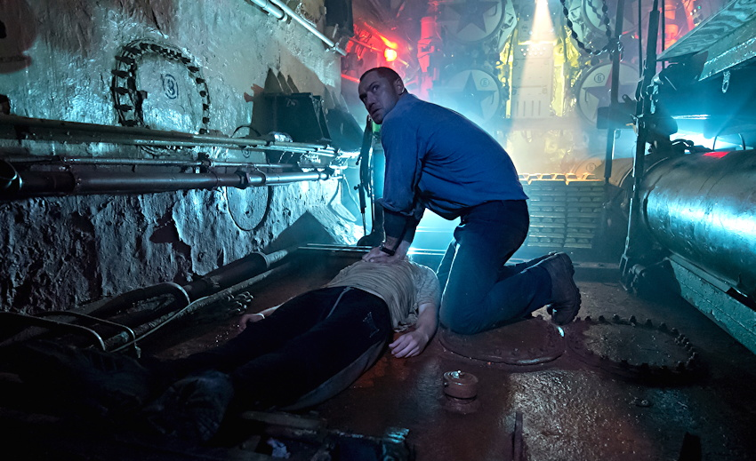"""Robinson (Jude Law) finds a body in the sub, from """"Black Sea"""""""