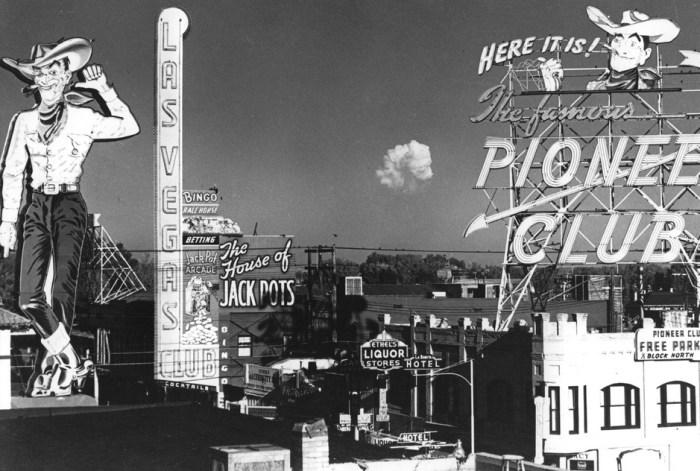 mushroom cloud behind las vegas downtown, circa 1965