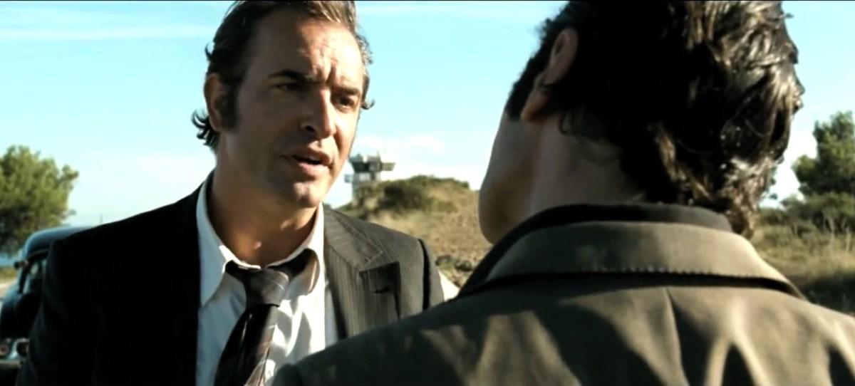 "Pierre Michel (Jean Dujardin) has a candid conversation with Gaëtan Zampa (Gilles Lellouche) in ""The Connection"""
