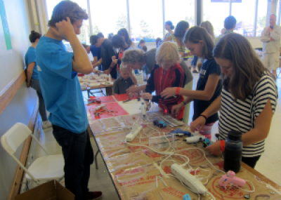 kids making cars at the noco makers faire