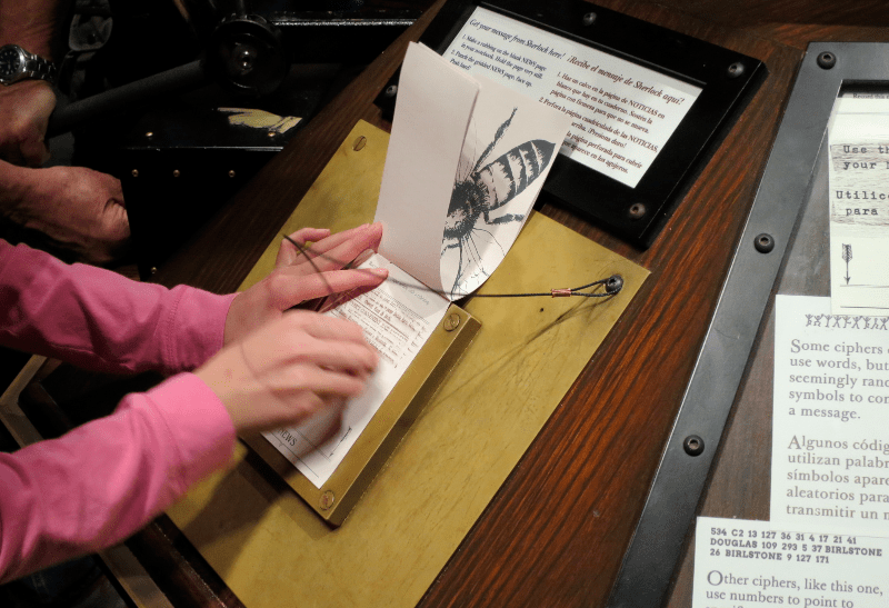 rubbing to break the code, sherlock holmes exhibition, denver museum nature science