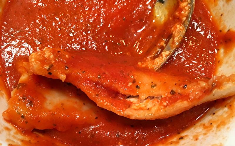 vegan cheese ravioli made by hand, with tomato sauce