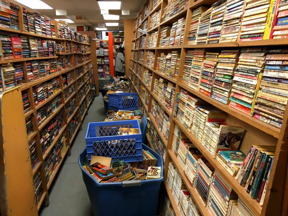 used book store aisle overflowing with books, kalispell montana