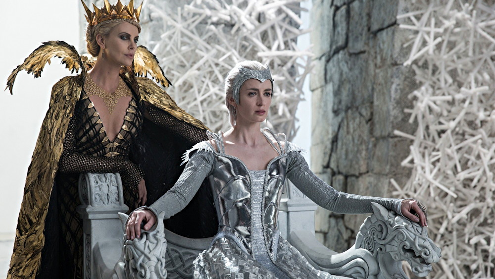 """Ravenna (Charlize Theron) looks down at Freya (Emily Blunt), from """"The Huntsman: Winter's War"""""""