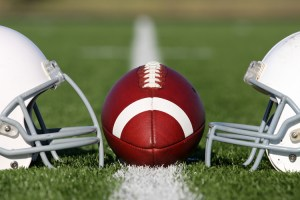 football and two helmets, on the field