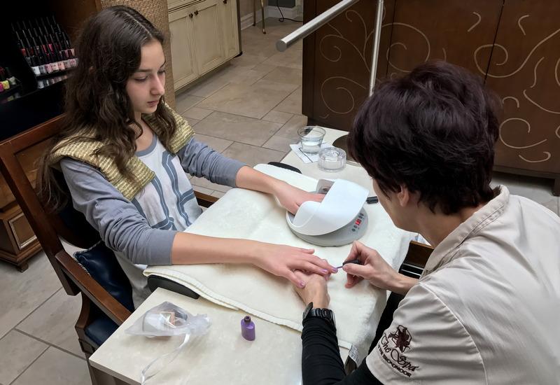teen girl getting manicure, broadmoor salon