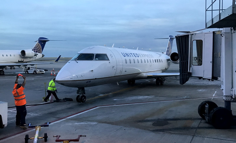 small commuter jet united express pulls up to gate, dia