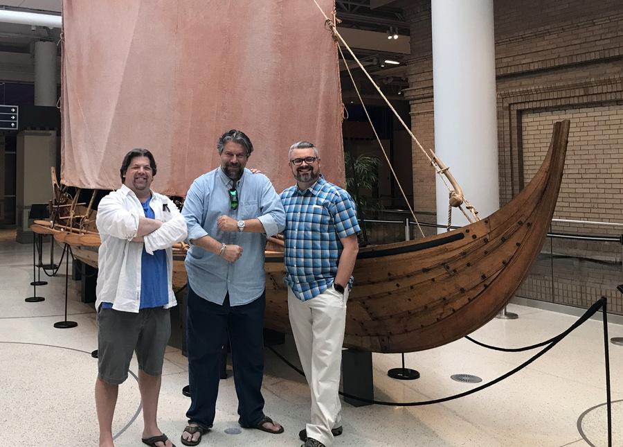three guys and a viking boat