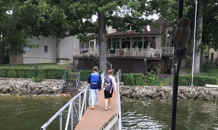 girls walking on dock