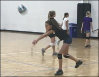 teen girl goes to volleyball camp clinic